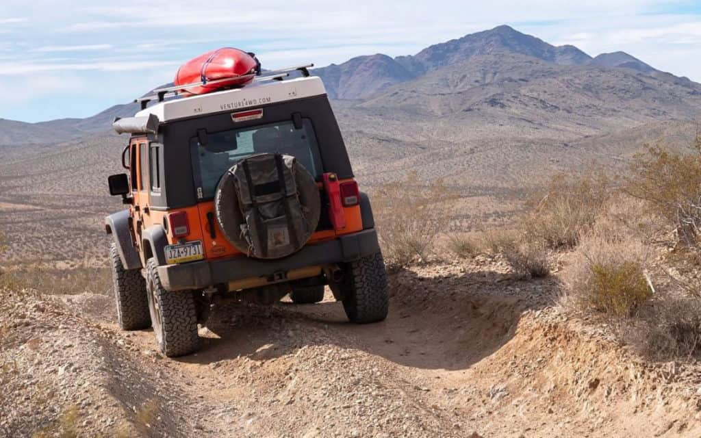 Jeep Wrangler camper on a dirt road in the desert