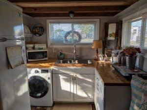 View of kitchen that includes a washer and dryer