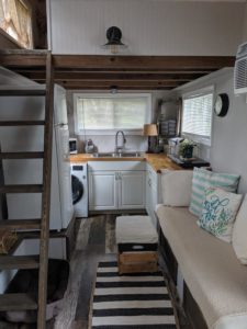 Ladder leading to loft and kitchen