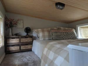Main sleeping loft with bed and dresser night stand