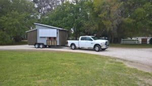 Truck moving tiny house
