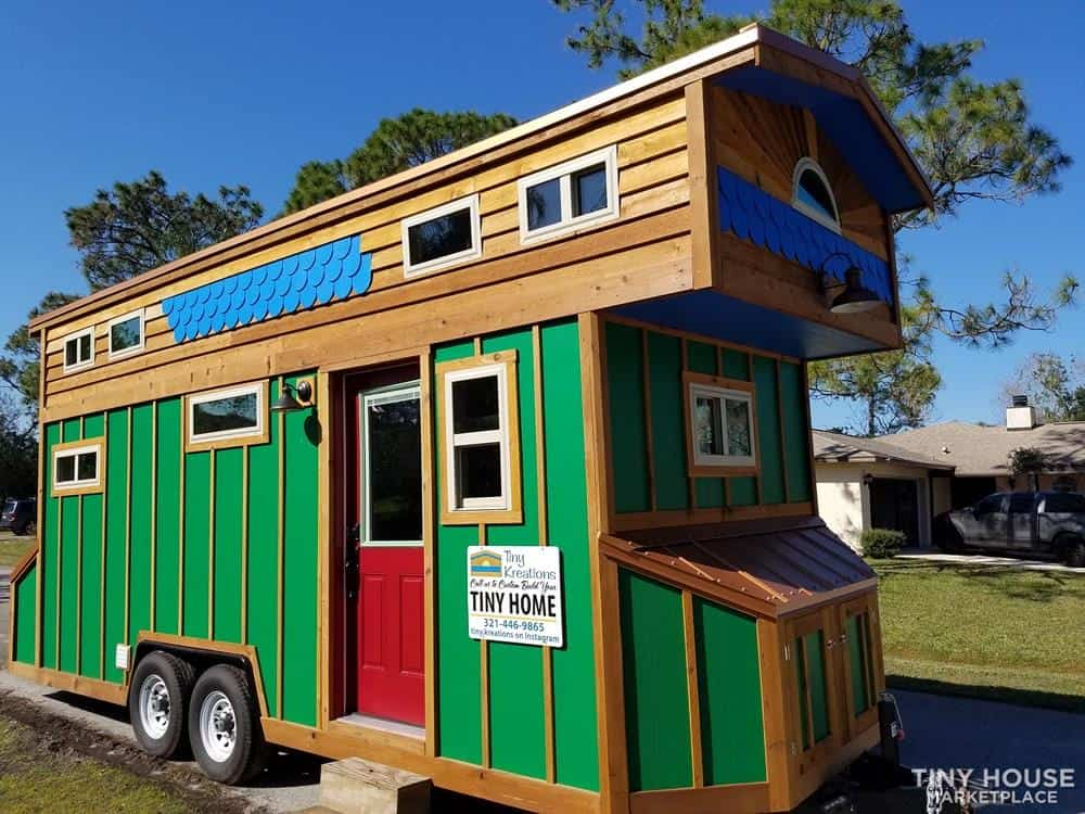 Exotic looking tiny home on wheels in Florida with bright green paint