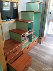 Stair case with lots of storage and shelving perfect for a tiny home