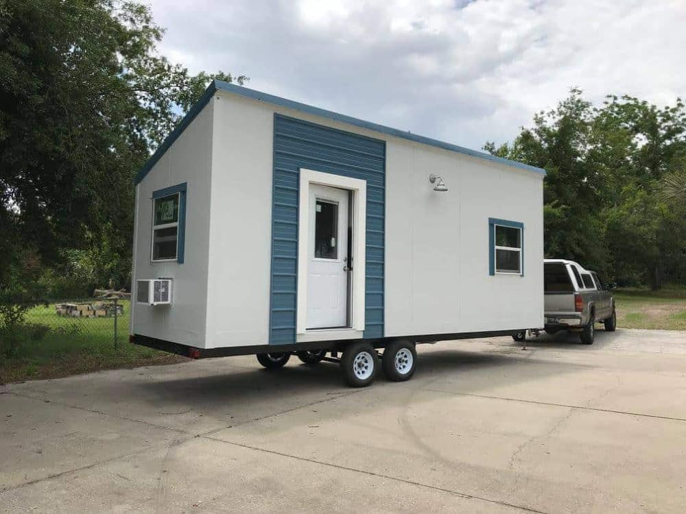 White and blue tiny home on wheels for sale in Florida