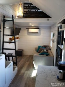Living area and a ladder going up to a second loft