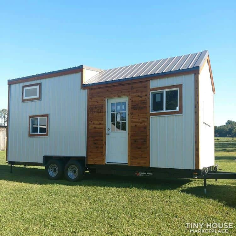 White Metal and wooden accent exterior tiny house on wheels