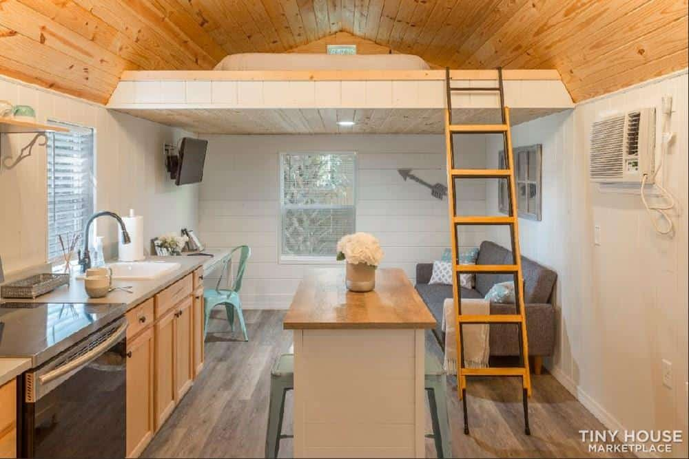 Interior of tiny house-includes kitchen with island, living area and loft