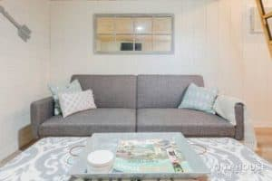 Couch and coffee table inside tiny house