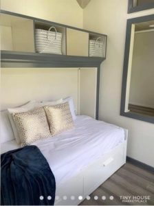 Simple bed with storage underneath and above
