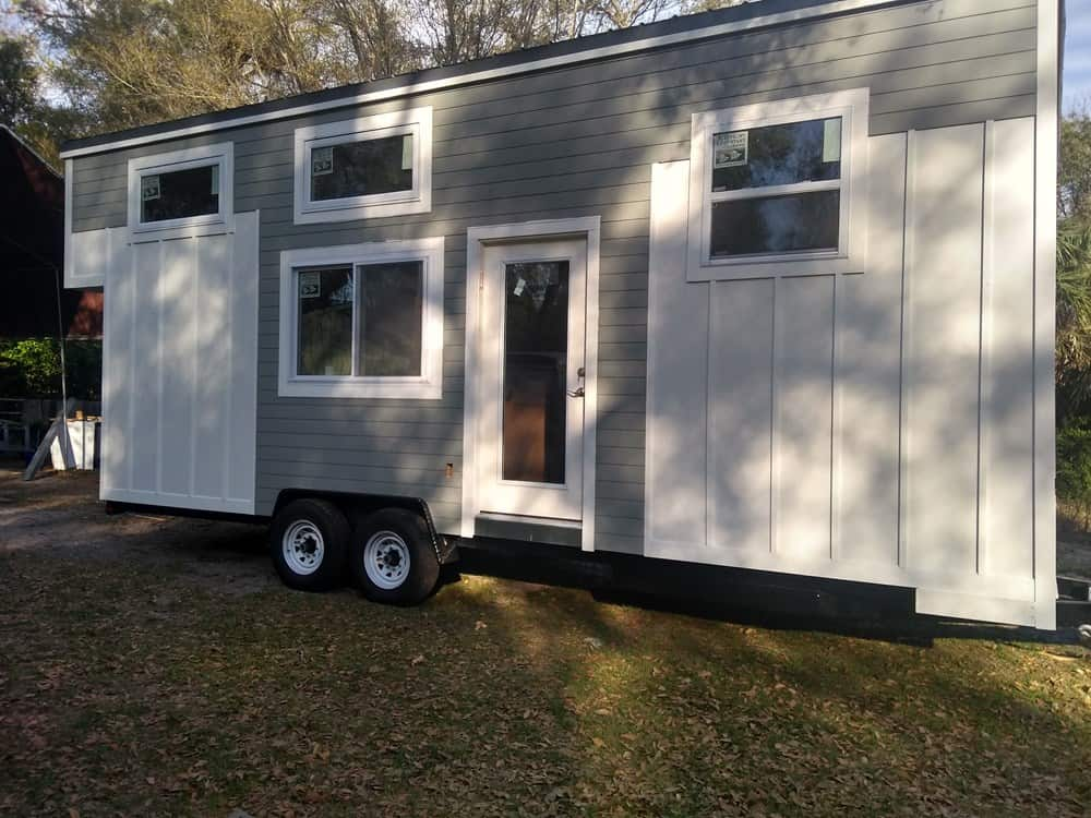 Gray and white modern looking tiny home on wheels