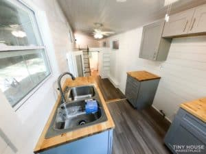 View from kitchen with sink and space for appliances