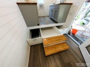 View of storage underneath kitchen.
