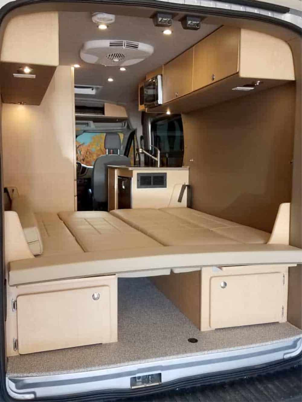 the twin beds folded down to make a larger campervan bed
