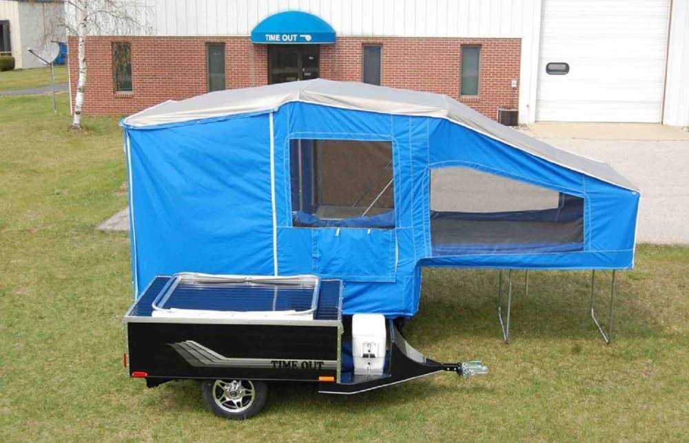 Bright Blue Time Deluxe motorcycle camper parked on grass