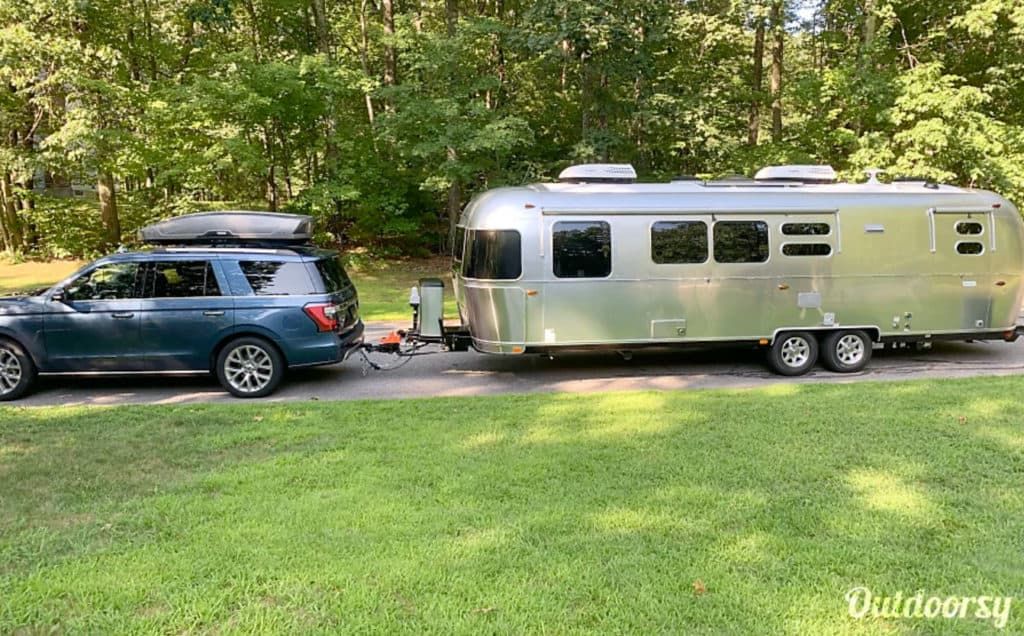SUV towing a large Airstream rental in New Hampshire