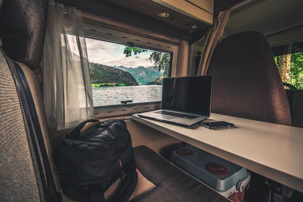 An opened laptop in an RV working on selling on Amazon