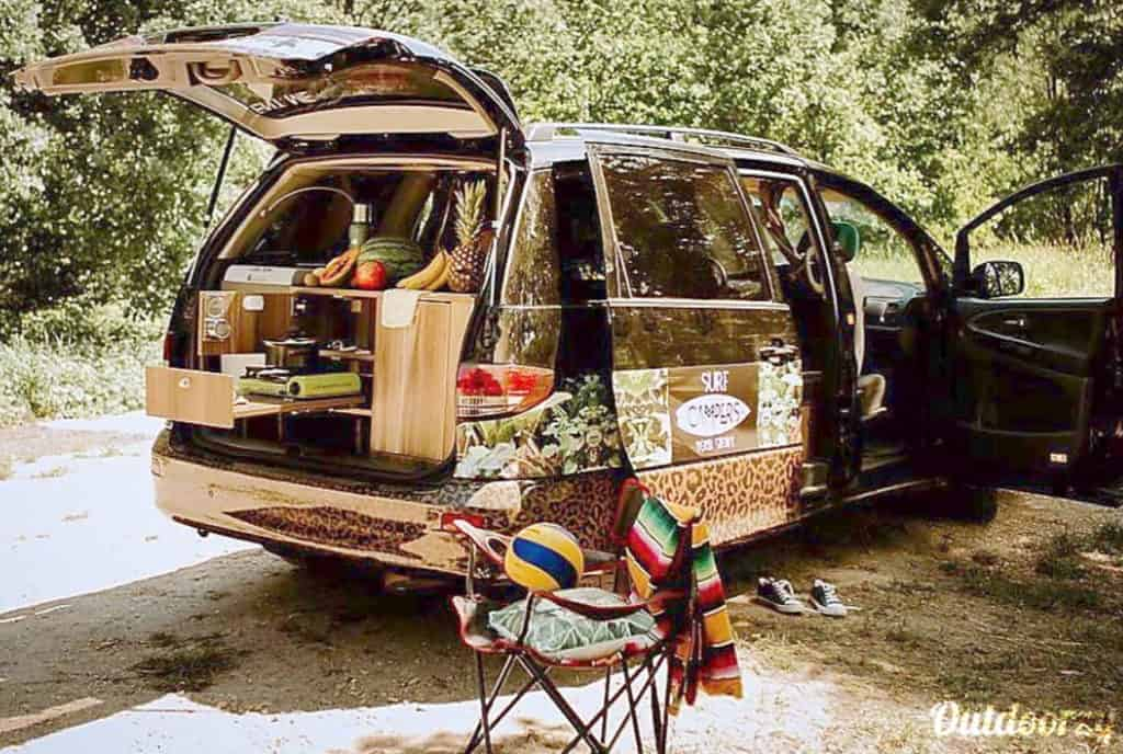 Budget campervan rental in Europe parked with trunk popped