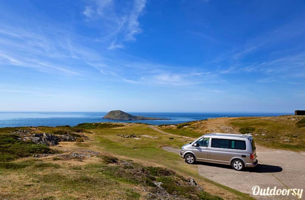 UK Campervan Hire Volkswagen van parked near the ocean