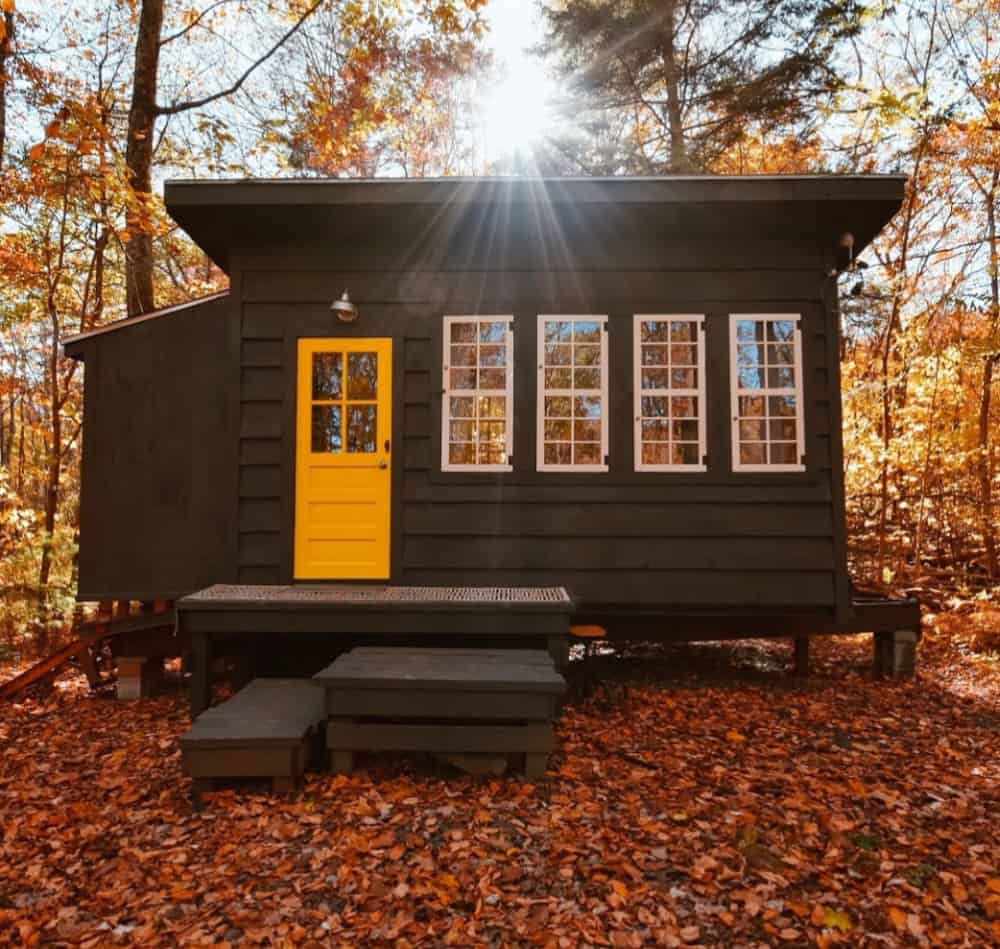 Tiny house on wooded land in the fall