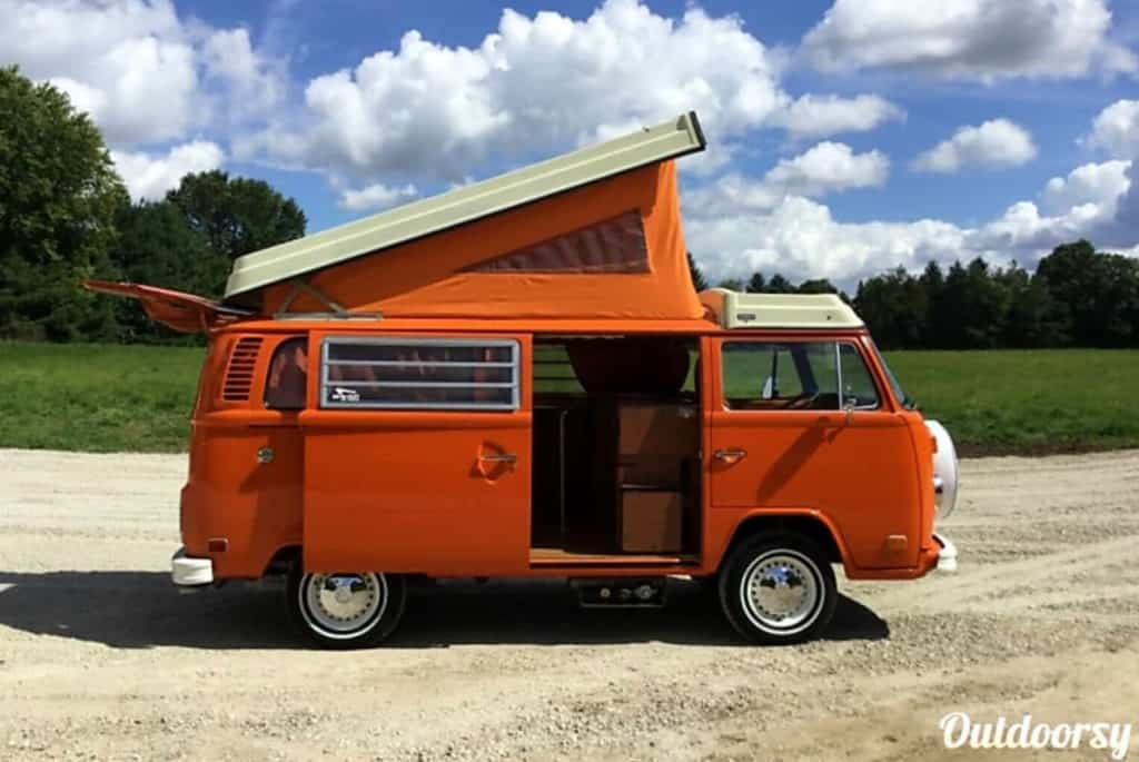 Bright orange VW campervan hire in Italy with pop top