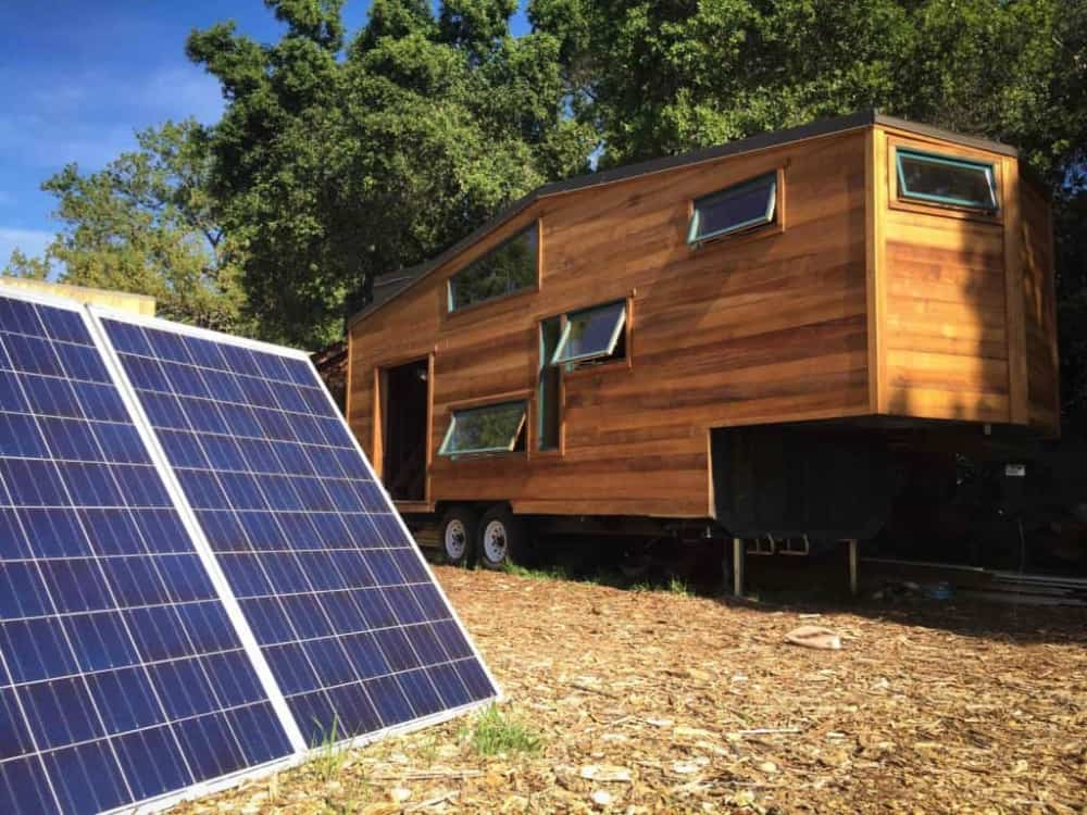 Tiny house on land with solar panels