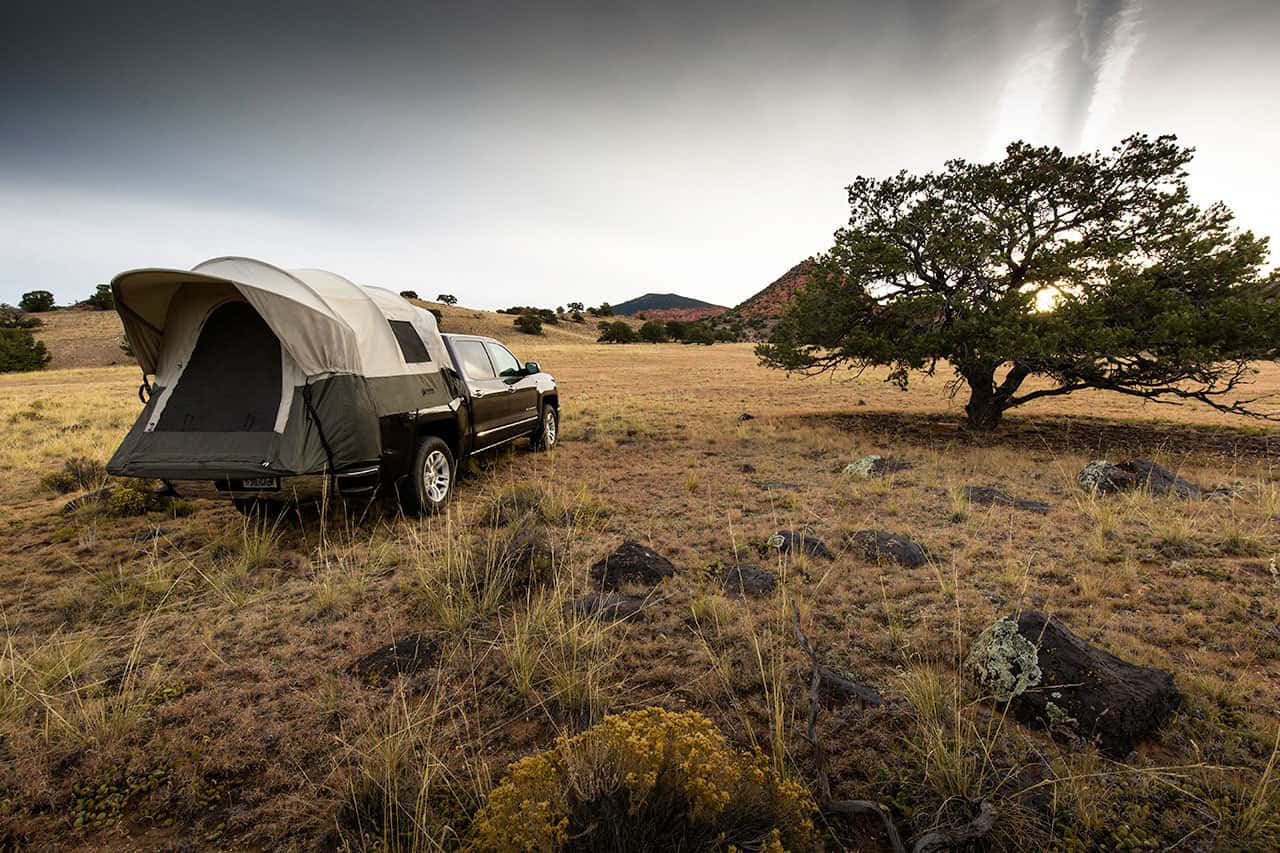 kodiak truck bed tent on a truck in a field