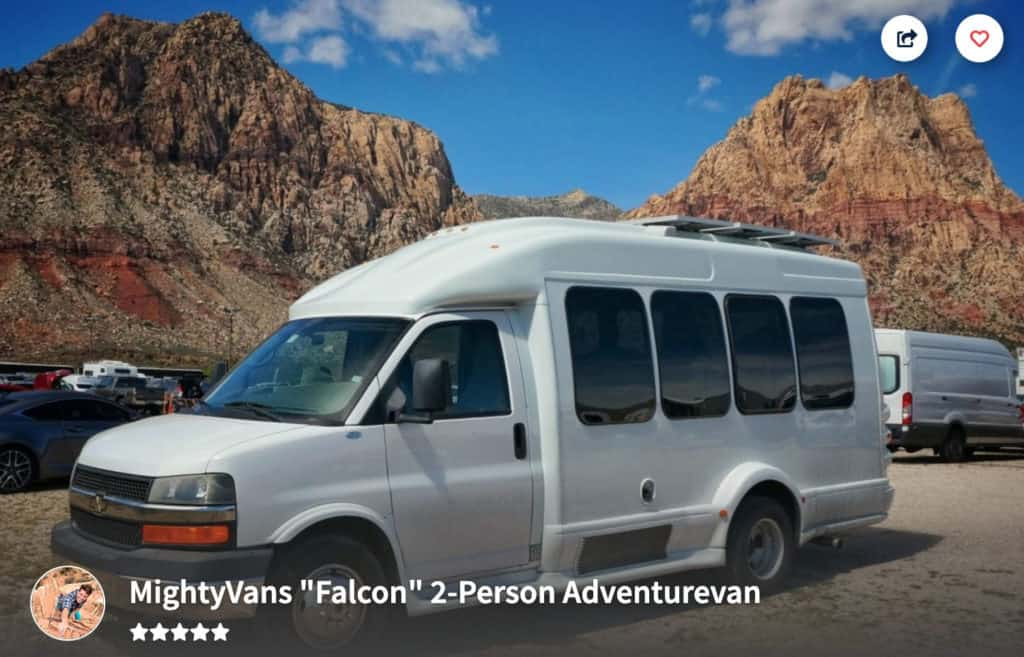 Custom built campervan with tons of windows parked near Utah's red rocks.