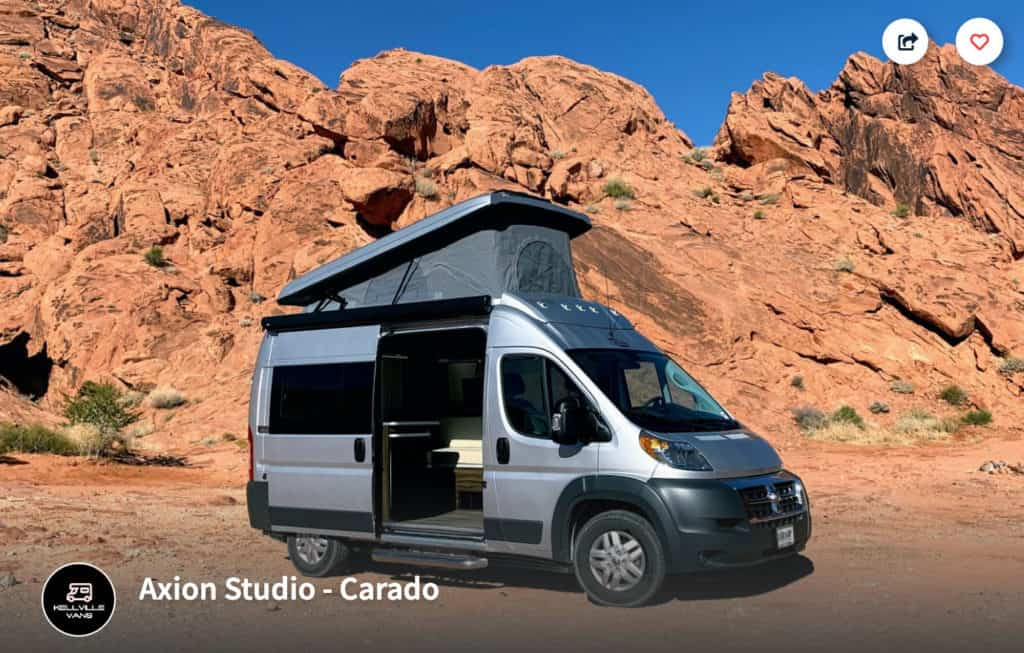 Axion Studio Carado campervan rental in Utah with the top up parked in front of red rocks.