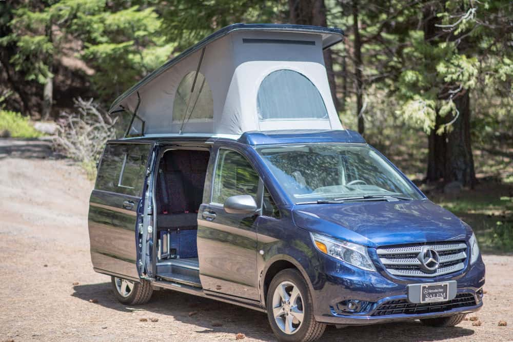 Blue Mercedes Metris camper with the pop-top up