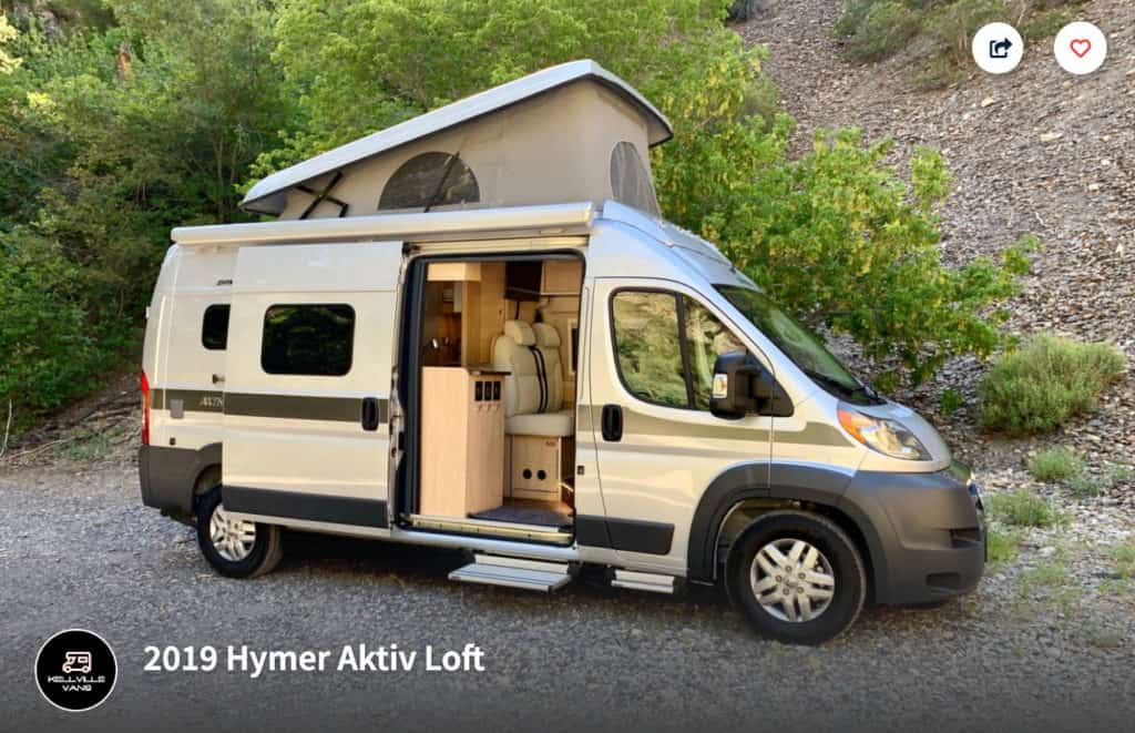 Hymer Activ campervan rental in Utah parked outside with side door open and pop top up.