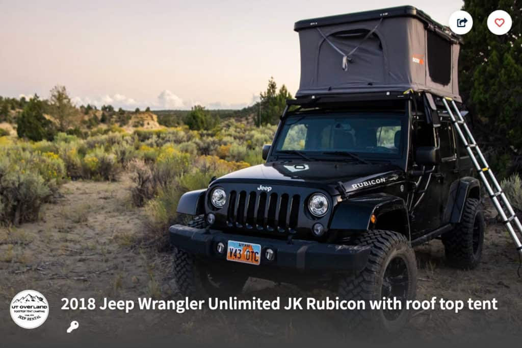 Jeep Wrangler with a rooftop tent parked in the desert