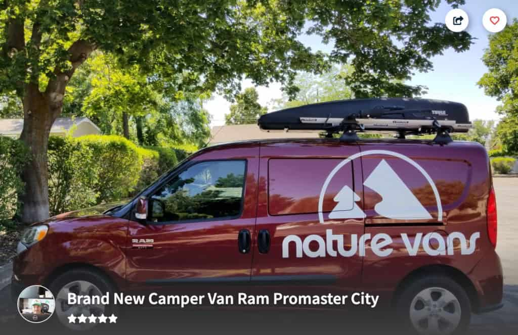 "Dodge Ram Promaster City with ""Nature Vans"" o the side parked under some trees."