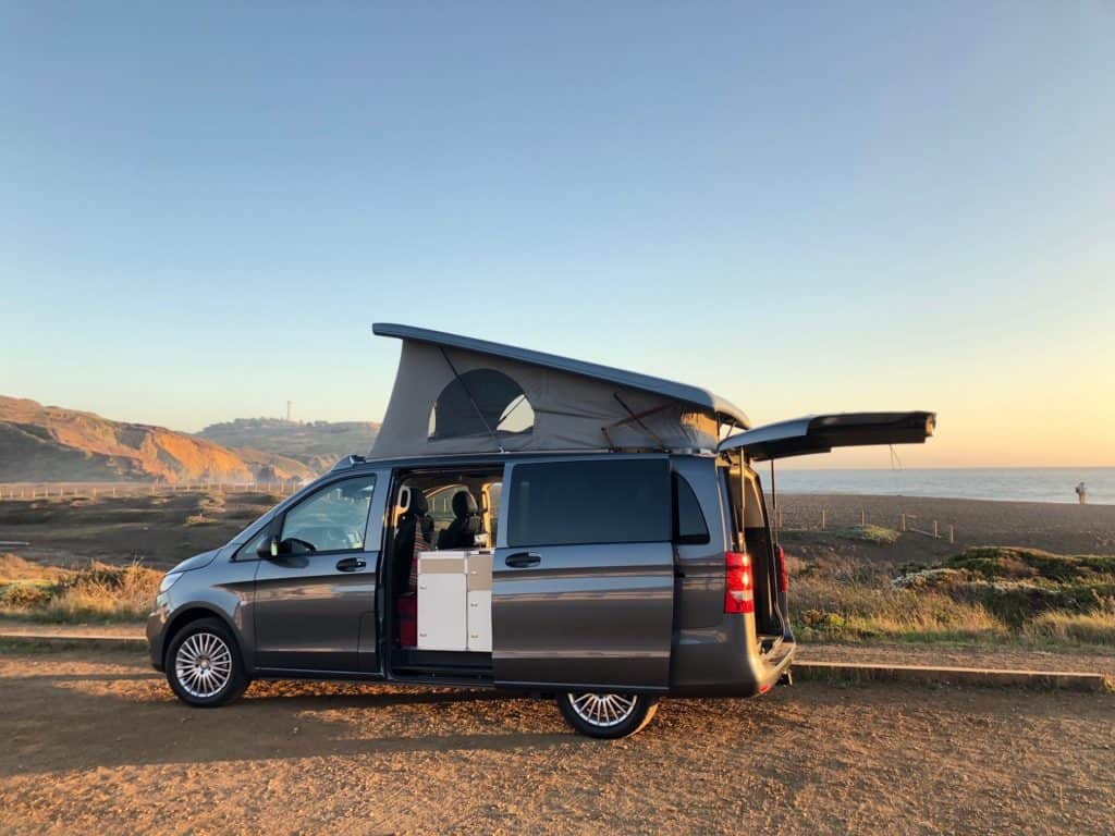 Mercedes Metris pop-top camper with pop up and back hatch open