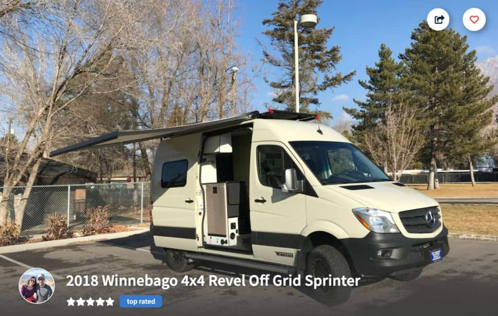 Winnebago campervan rental in Salt Lake City with awning extended in a parking lot.