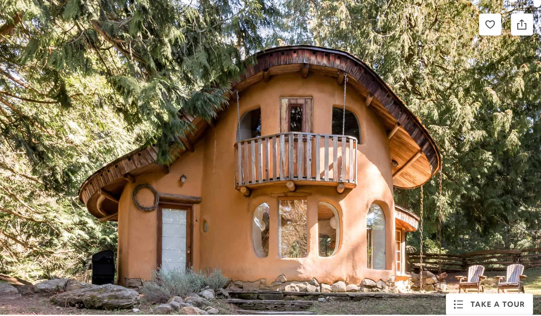 two story cob house in the woods