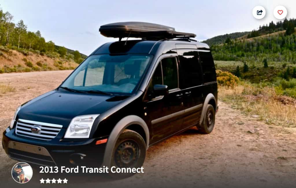 Black Ford Transit Connect Campervan Rental in Utah parked on a dirt road