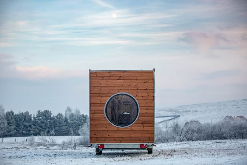 tiny house in the snow on a small tiny house trailer