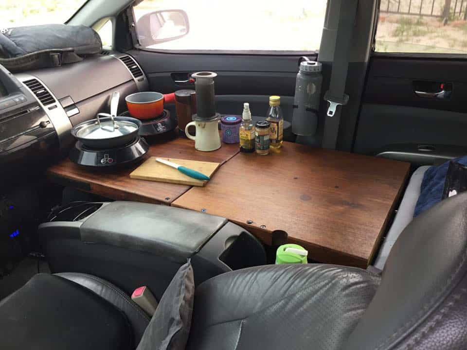 Living in a Prius means getting creative. This teak board is David's kitchen during the day.