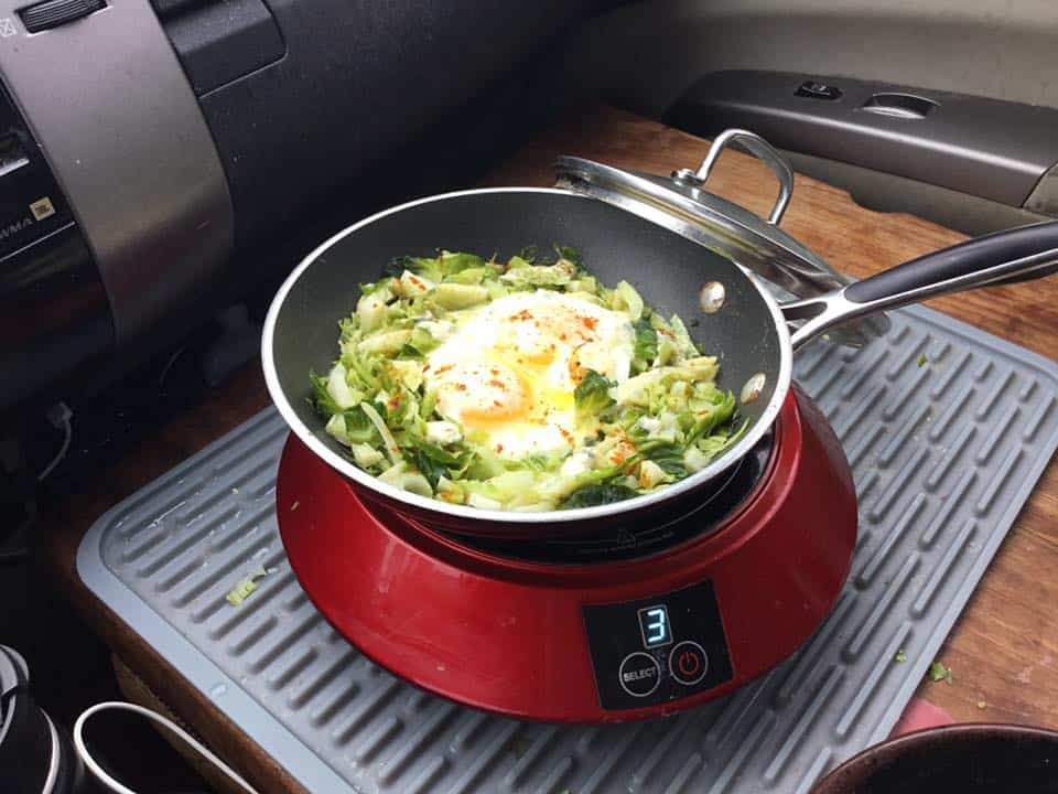 Pot of food cooking on a stove in David's Toyota Prius.