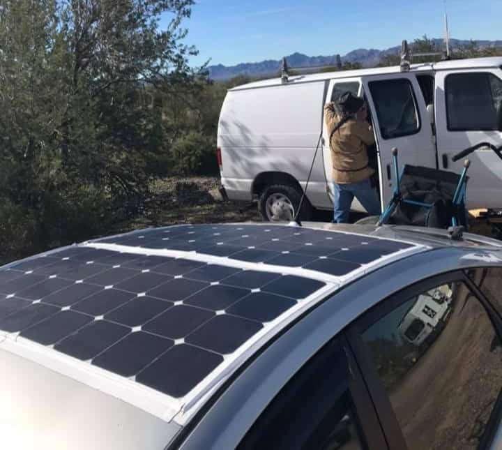 Solar panels mounted on the roof of a Prius camper