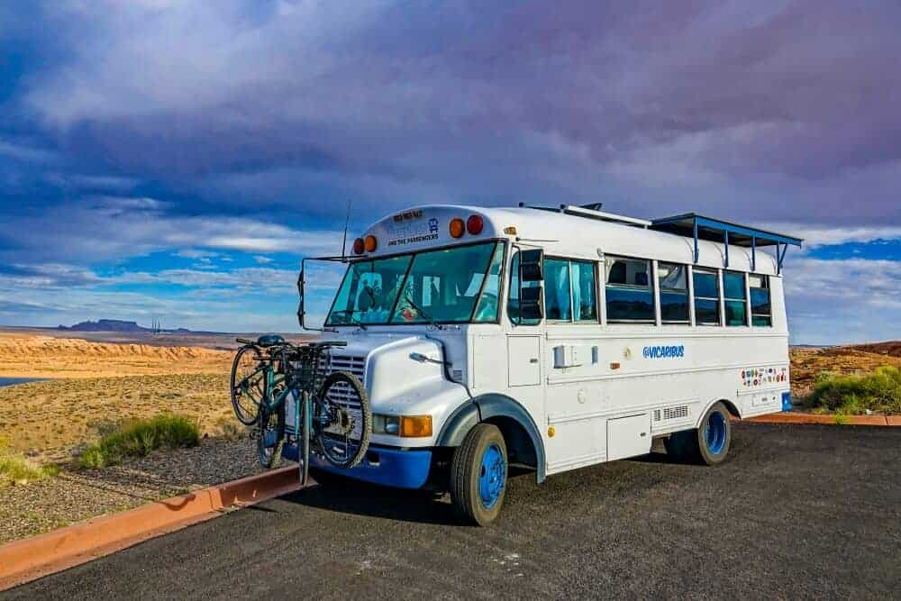 short bus conversion parked on the side of the road