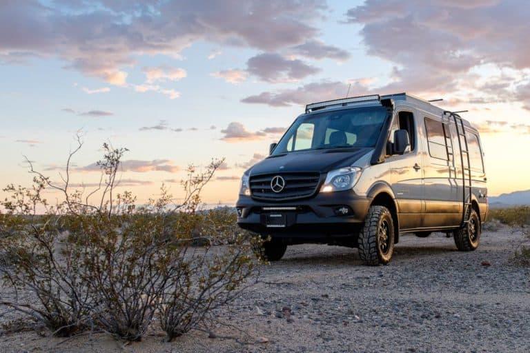 Sportsmobile Sprinter van custom conversion parked in the desert