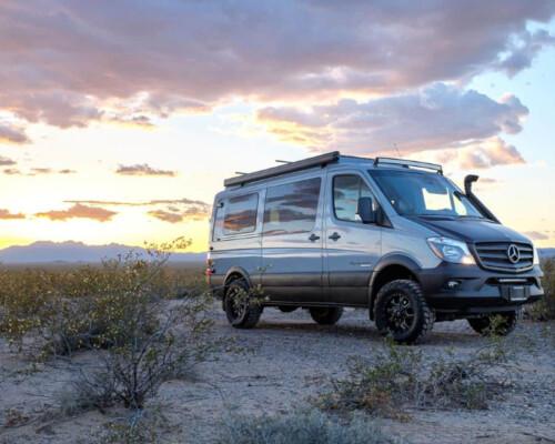 sportsmobile sprinter van for sale parked in the desert at sunset