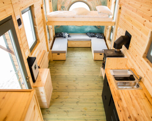 Tiny house furniture inside a wooden interior tiny home.