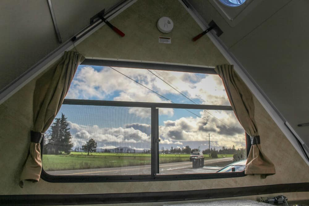 View out the window of a Chalet hard sided pop up camper.