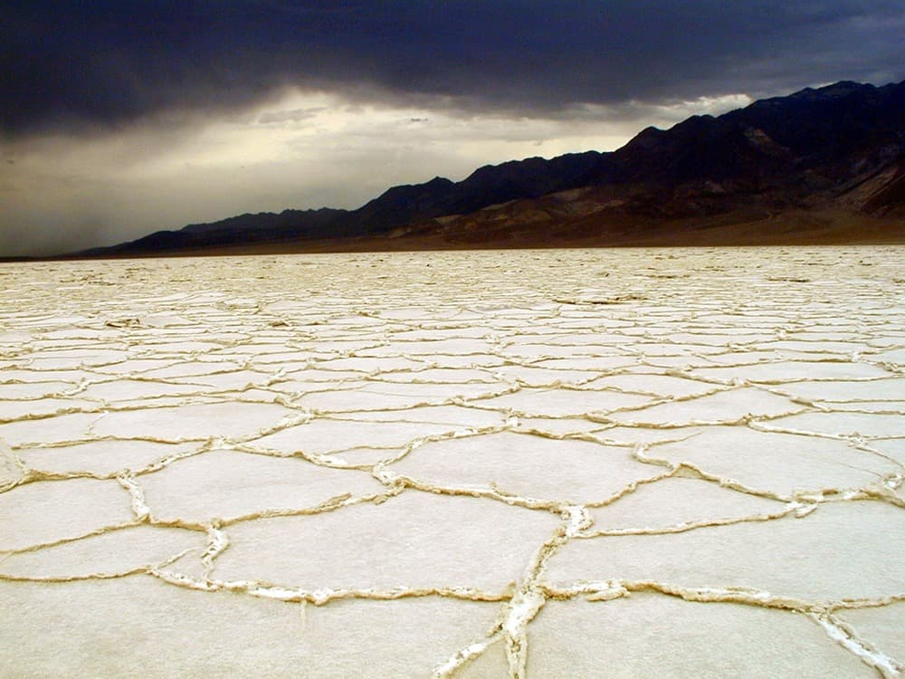 Cracked salt flats in Badwater Basin, one of a few areas you can't find free camping in Death Valley.