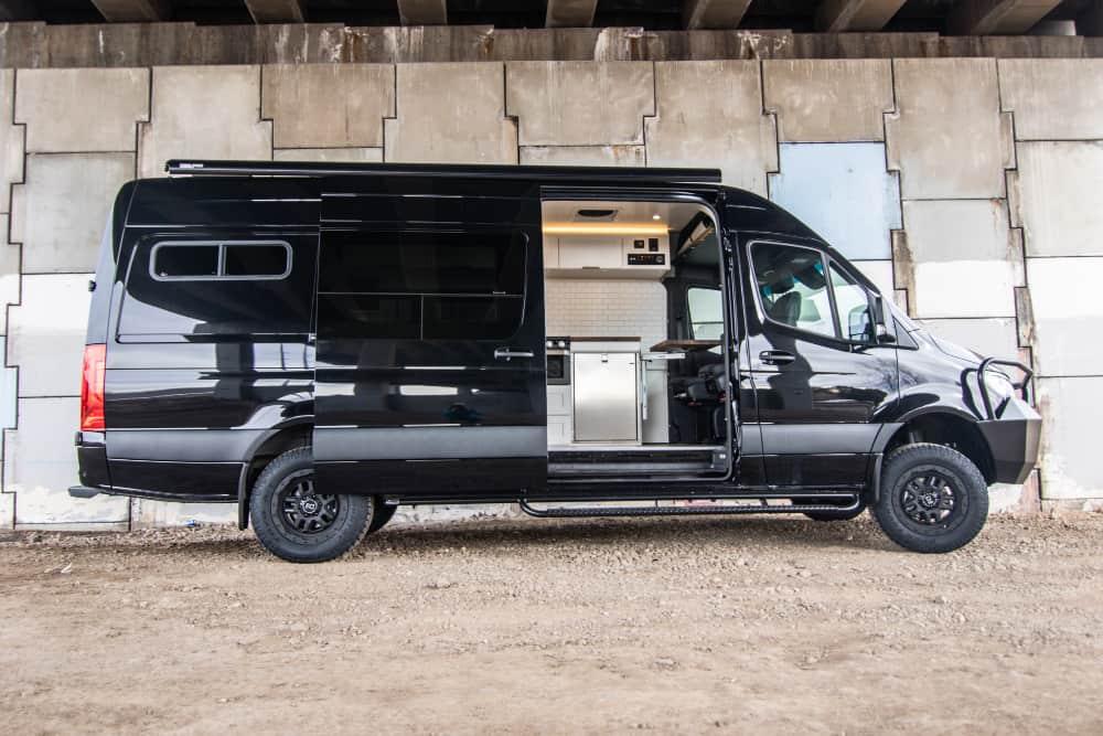 black mercedes sprinter custom conversion with kitchen inside
