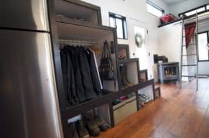 hOMe tiny house under stair storage.