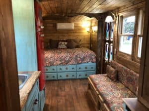 Interior view of the bed and couch of the Gypsy wagon.