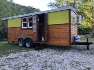 Side view of the Gypsy tiny house on wheels for sale in Texas.